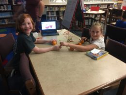 Students trying out MakeyMakey circuits